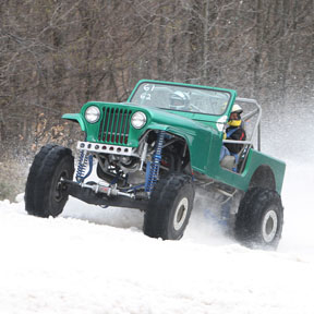 Tyler Bylsma races his Green Jeep at the Schuss Mountain Snow Challenge in Mancelona