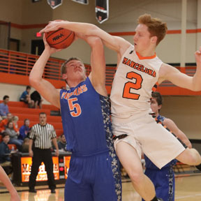 Jack Kloc (pictured on right) stops a shot by a Central Lake player at Mancelona